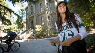 Girl student in front of Deady Hall