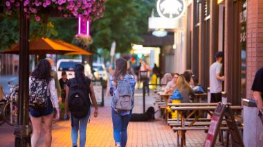 Student walking in downtown Eugene
